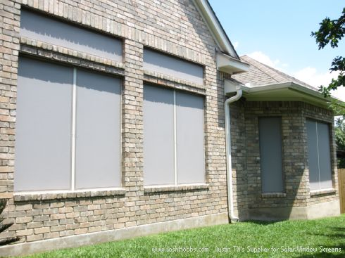 Solar Window Screen Installation - Round Rock Home, Grey solar screen fabric with Champagne Frame.